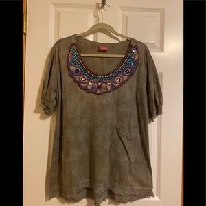 Fun top with bead detail at neck.